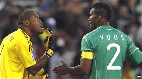 Nigeria goalkeeper Vincent Enyeama, left, talks to his teammate Joseph Yobo
