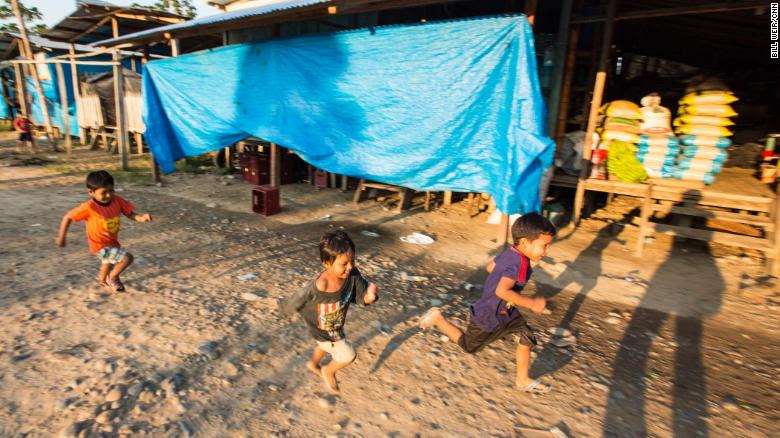 Kids play near a camp of illegal gold miners in the Madre de Dios region of Peru.