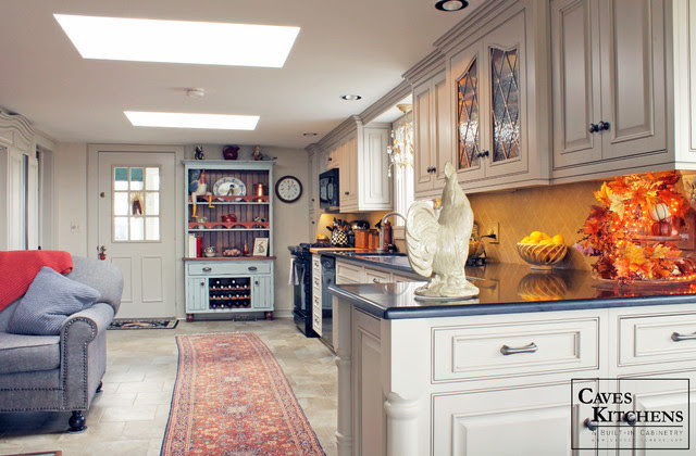 Custom Cream French Country Kitchen with Blue Hutch - traditional