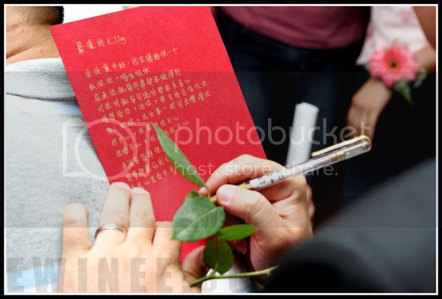 signing-contract-groom