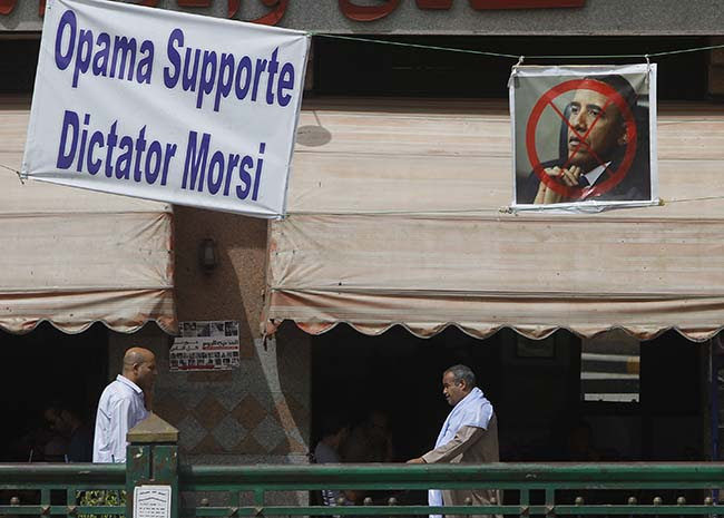 PA 16749300 Egypt deposes the Muslim Brotherhood: the best Anti Obama banners