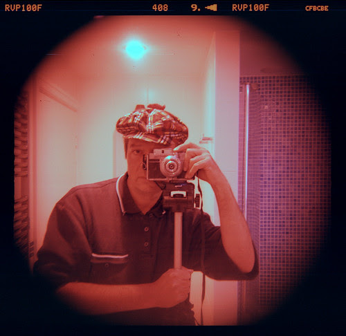 reflected self-portrait with Koroll 24 camera and Tam o' Shanter by pho-Tony