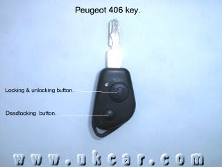 Peugeot 406 key with seperate daedlock button.