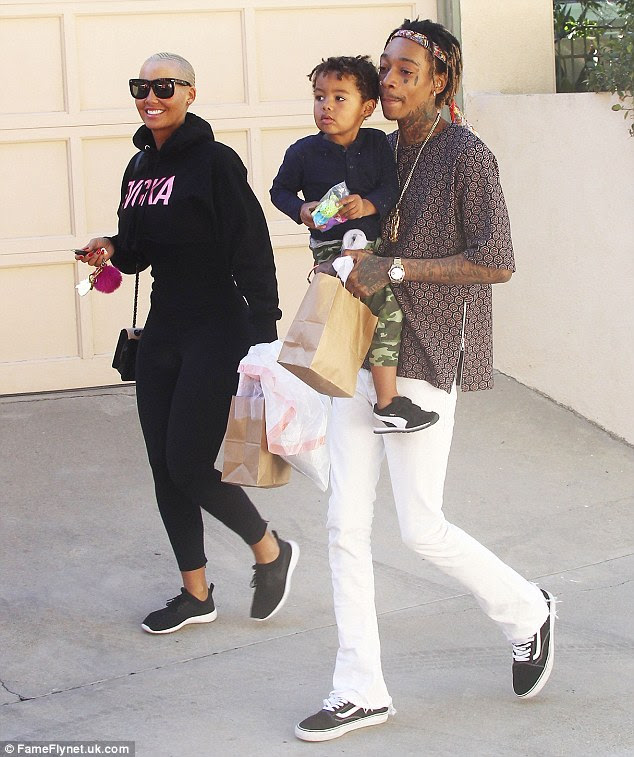 Wild card: But perhaps it was her reunion with ex Wiz Khalifa that spurred on the need for some confidence building pads