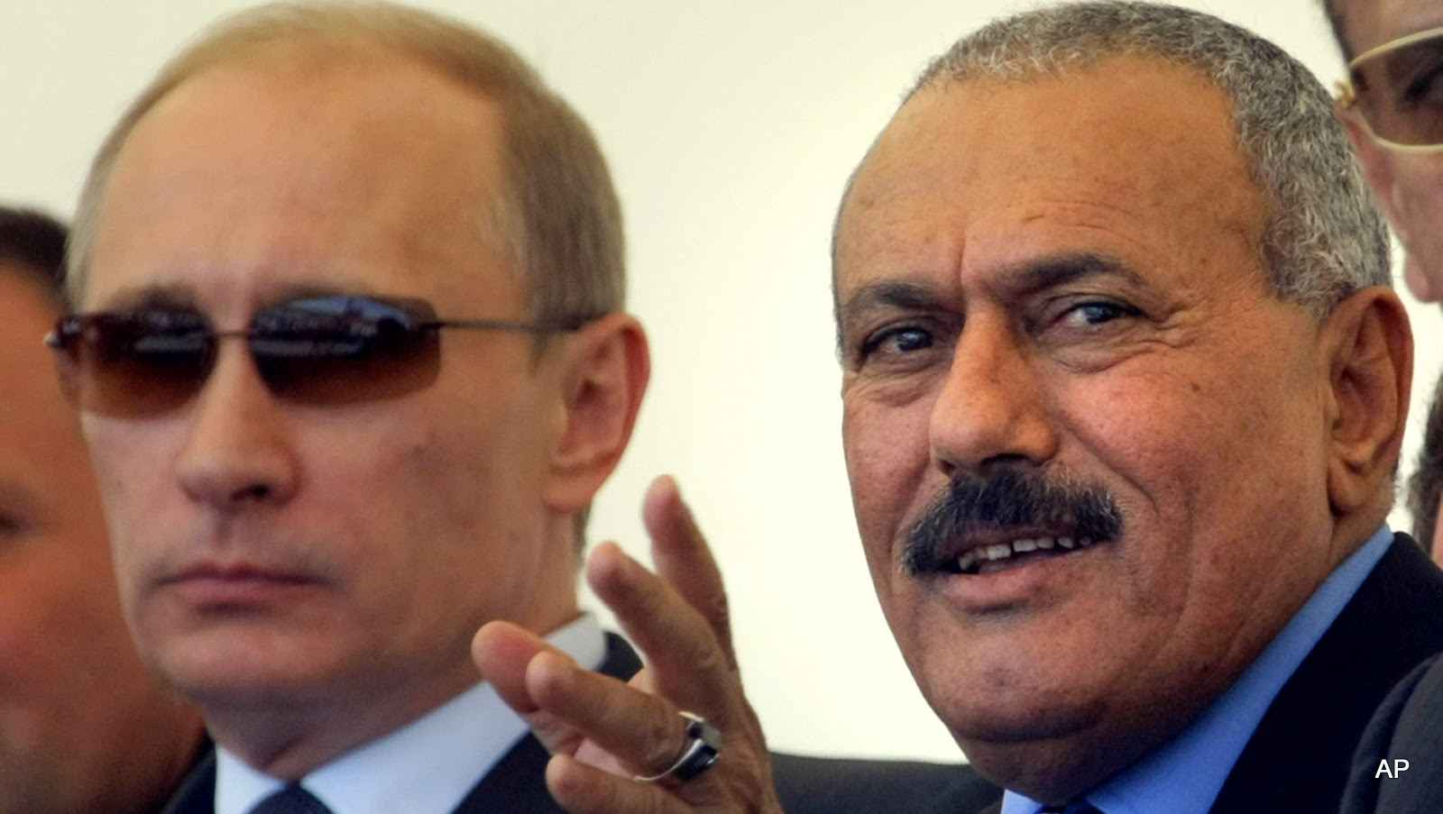 """Russian Prime Minister Vladimir Putin, left, and Yemen's President Ali Abdullah Saleh watch a military show as they attend the international forum """"Technologies in machine building 2010"""" in Zhukovsky outside Moscow, Wednesday, June 30, 2010."""