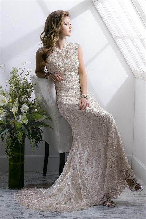 Heavily beaded embroidered metallic lace overlay featuring