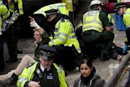 Mock casualties are treated by the emergency services during a drill in preparation for the London Olympics in February. An Islamist terror suspect in Britain charged with breaking restrictions on his movements had crossed through London's Olympic Park five times, newspapers reported Sunday. (AFP Photo/Ben Stansall)