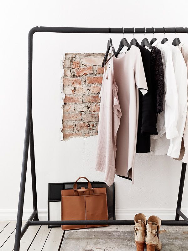 LE FASHION BLOG HOME DECOR IDEAS OPEN CLOSETS PART 2 FASHIONABLE HOME INSPIRATION CLOTHES ON DISPLAY  EXPOSED BRICK MINIMAL CLASSIC BLACK NUDE WHITE LOOKS TAN ANKLE BOOTS TAN LEATHER SUITCASE PORTFOLIO BAG BLACK WARDROBE CLOTHES RACK VIA STADSHEM 1 photo LEFASHIONBLOGOPENCLOSETSPART2VIASTADSHEM1.jpg
