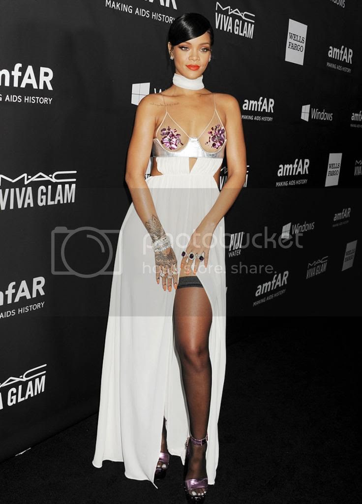 Miley Cyrus and Rihanna at amfAR's Gala photo rihann-amfar-gala-2014-tom-ford.jpg