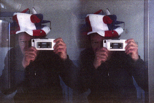 reflected self-portrait with Loreo Stereo camera and jester's hat by pho-Tony