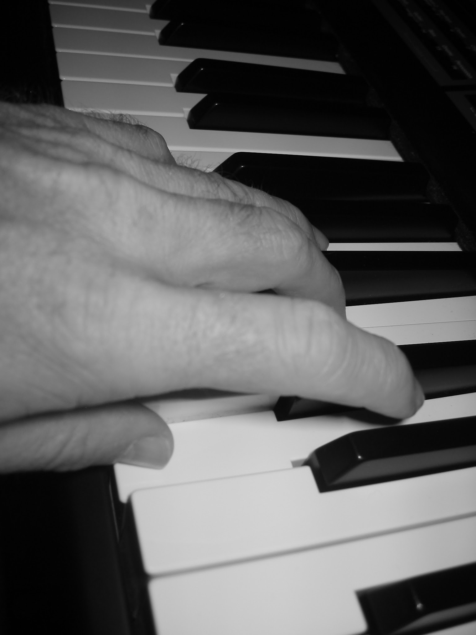 black and white of fingers on piano - soul amp