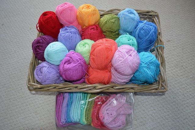 Blanket yarns in wicker basket