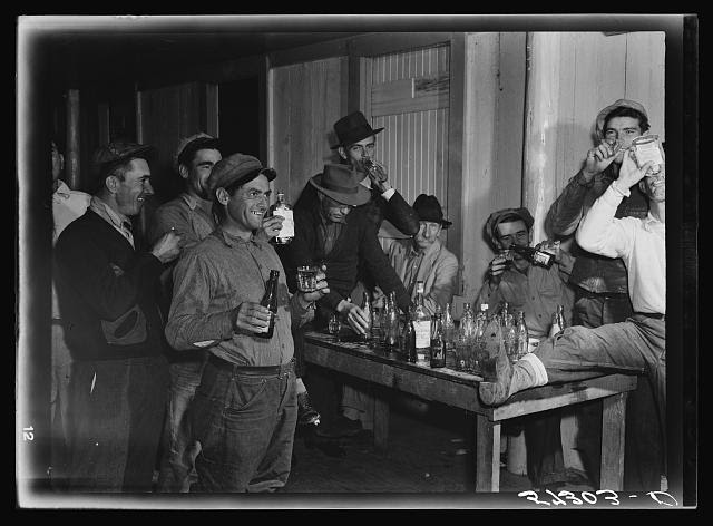 Spanish muskrat trappers have a round of drinks after each lot is sold at the fur auction held in a dance hall on Delacroix Island, Louisiana