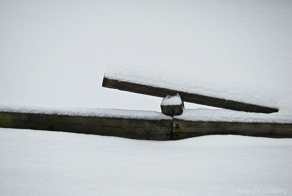 fence railing, buried in snow