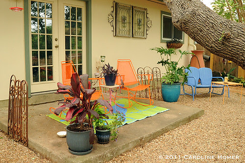 A colorful back porch seating area