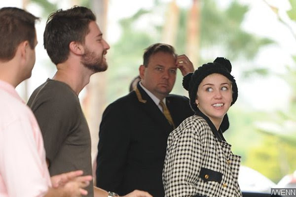 Miley Cyrus Reacts to Patrick Schwarzenegger Cheating Rumors With Bizarre Pic