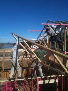 Hoisting Roof Truss into Position