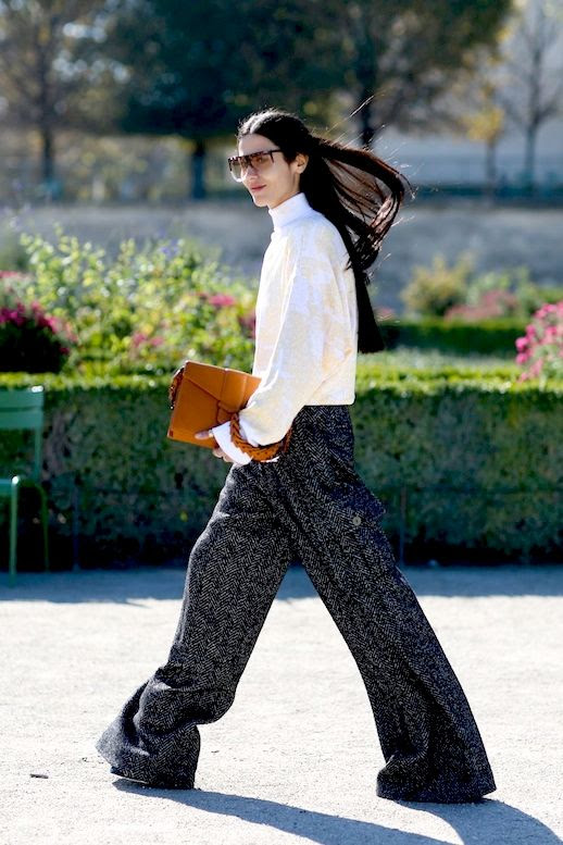 Le Fashion Blog Street Style Pfw Flat Top Sunglasses White Turtleneck Top Baggy Wide Leg Trousers Brown Clutch Via Refinery29