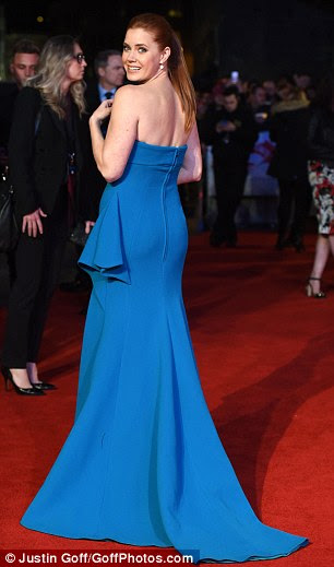 Baby got back: The form-flattering frock was the ideal outfit for making the most of her svelte form