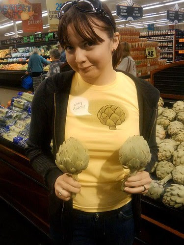 Py McSmoogieface is holding a pair of lovely artichokes by woot.com