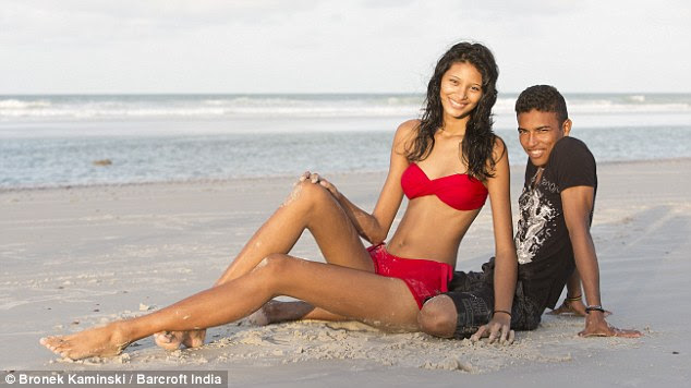 Loved up: At 6ft 8in-tall, Elisany towers over her smitten  partner, who is just 5ft 4in
