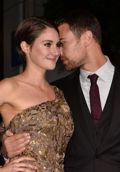 """Actors Shailene Woodley (L) and Theo James arrive at the premiere of Summit Entertainment's """"Divergent"""" at the Regency Bruin Theatre on March 18, 2014 in Los Angeles, California."""