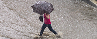 Photo of a woman in heavy rain.