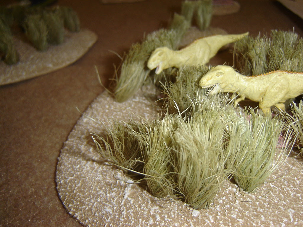 Pair of Tyrannosaurs skulk in grasses