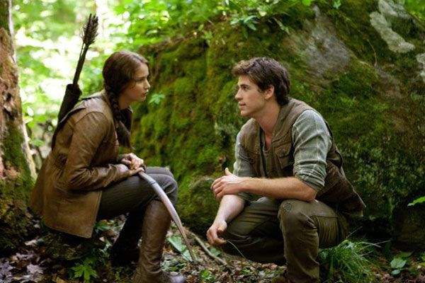 Katniss Everdeen and Gale Hawthorne (Liam Hemsworth) share a moment in District 12 before THE HUNGER GAMES.