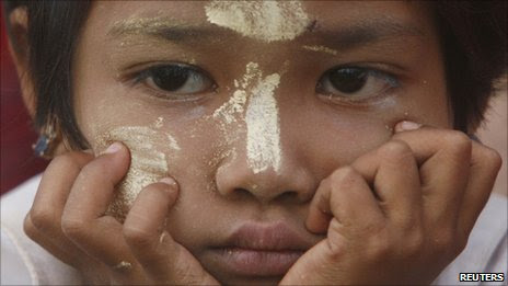 A Mon girl attends a ceremony in Mawlamyaing village near the Burma-Thai border on 28 August 2007