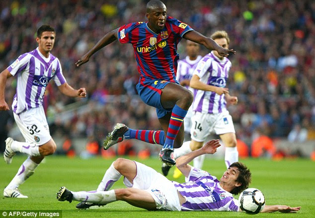 Yaya Toure skips past the challenge of Valladolid's Hector Font during that final day game in 2010