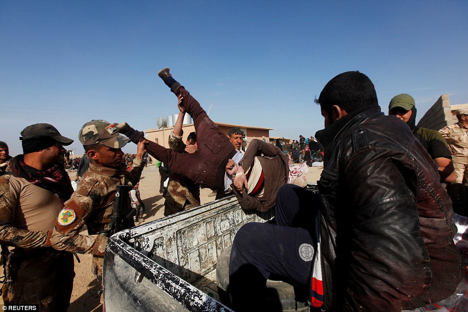 Iraqi Special Operations Forces arrest a person suspected of belonging to the terror group Islamic State in western Mosul on February 26