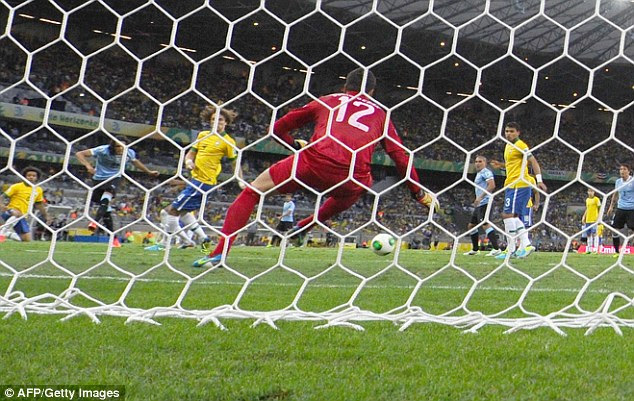 Slotted: Cavani found the bottom corner as he guided the ball past the despairing Juilo Cesar