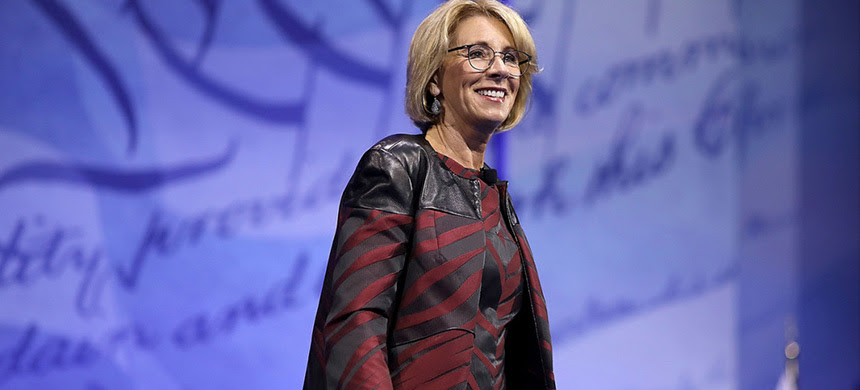 Betsy DeVos is preparing to issue a declaration that companies collecting federal student loans are off limits for state lawmakers and regulators. (photo: Chip Somodevilla/Getty Images)
