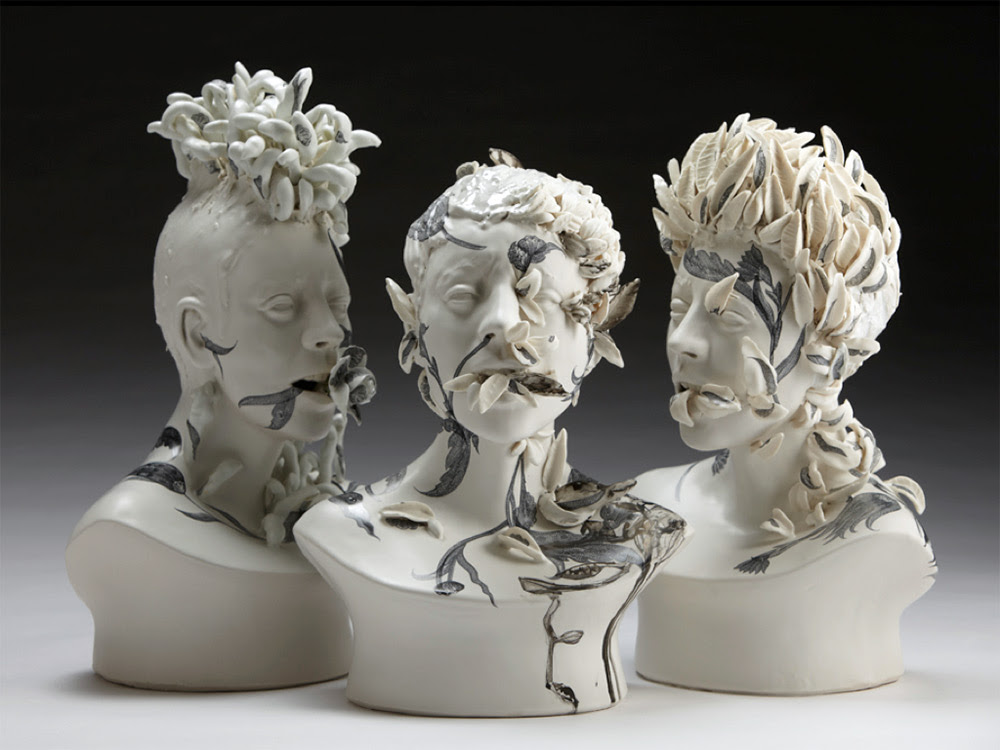 Haunting Ceramic Faces Overgrown with Vegetation by Jess Riva Cooper sculpture ceramics