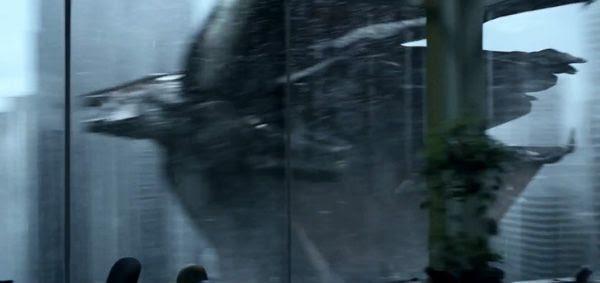 M.U.T.O. flies past a skyscraper in GODZILLA.