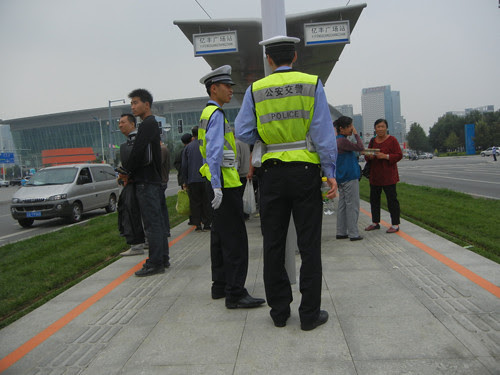 DSCN6285 _ Policemen at Tram Stop, Shenyang, China