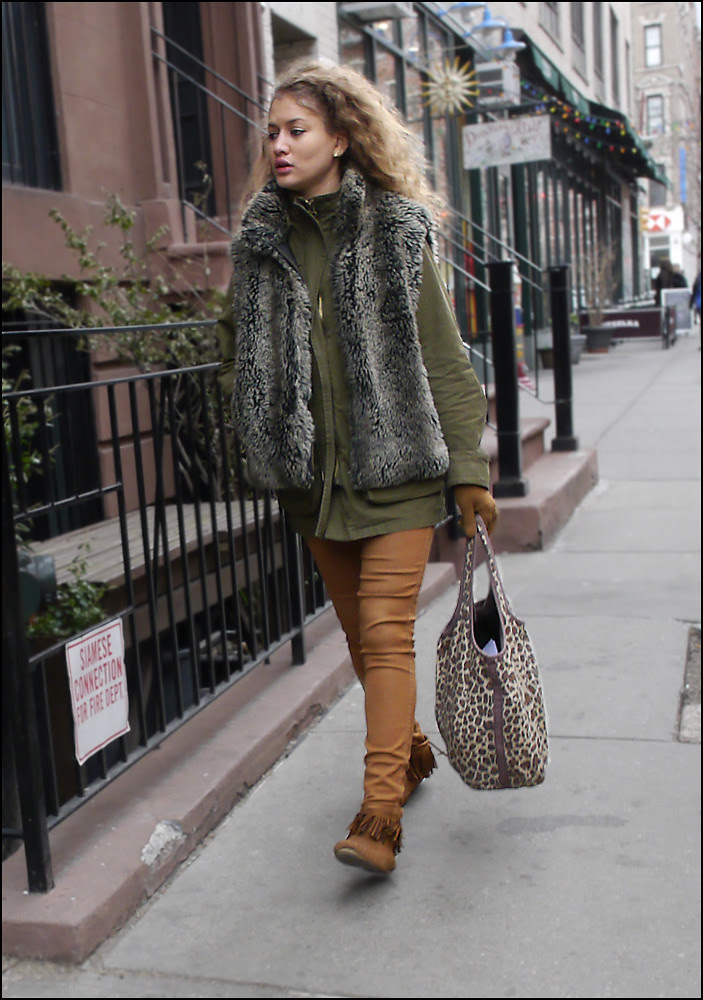 w green fur vest over green coat burn orange pants fringed moccasins leopard print bag ol bm