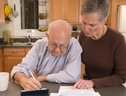Photo of a senior couple paying bills