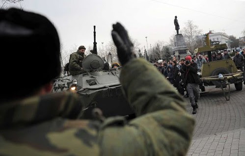 A Russian army officer helps armored personnel carrier in Sevastopol, Ukraine's  Black Sea Port. The United States supported fascist coup is raising tensions within the region. by Pan-African News Wire File Photos