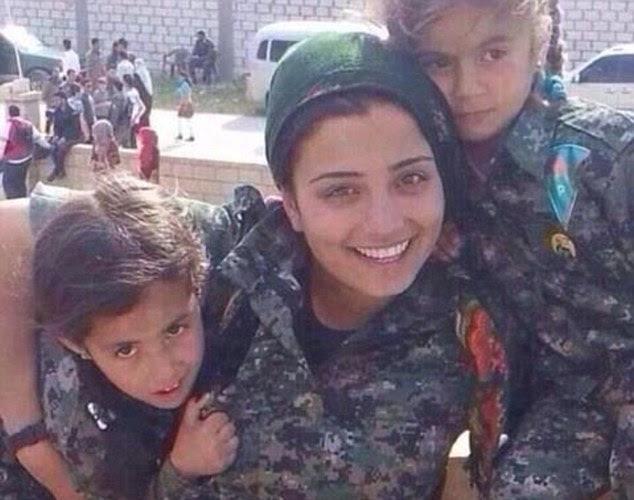 http://www.barenakedislam.com/wp-content/uploads/2014/10/1412669587115_wps_5_A_Kurdish_woman_fighting_.jpg