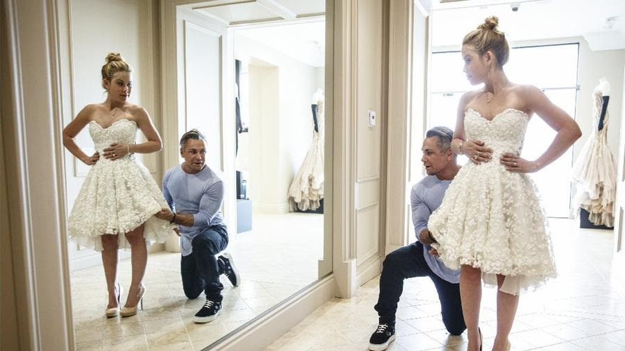 Couture designer Mark Zunino examines the engagement party dress he designed for Olympic gold medal-winning skater Tara Lipinski inside his Beverly Hills showroom in March.