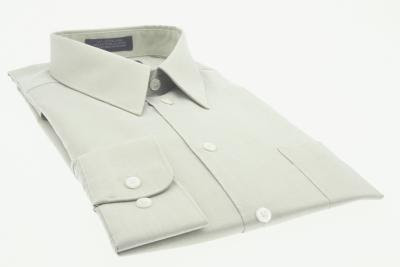 A classic white button-up shirt provides clean contrast to a gray t-shirt.