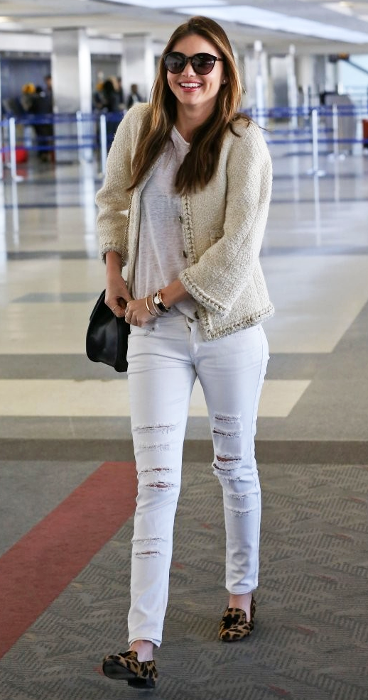 LE FASHION BLOG MIRANDA KERR LAX AIRPORT LOOK OFF WHITE CHANEL BOUCLE TWEED JACKET SHEER WHITE TEE T SHIRT DISTRESSED WHITE DENIM RIPPED JEANS TASSELED TASSEL LEOPARD PRINT LOAFERS VALENTINO BLACK SHOULDER BAG CAT EYE SUNGLASSES SMILE CARTIER JUST UN CLOU SCREW NAIL BRACELET ROUND BLACK WATCH GET THE LOOK photo LEFASHIONBLOGMIRANDAKERRAIRPORTLOOKBOUCLEJACKETTEEDISTRESSEDWHITEDENIMLEOPARDLOAFERS-2.png