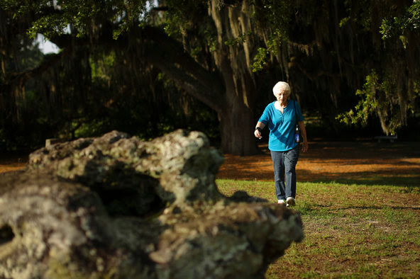 Mildred Johnston walking along a path in Kanapaha Veterans Memorial Park in Gainesville, Fla. Ms. Johnston participated in a large study that showed the benefits of walking for older people.