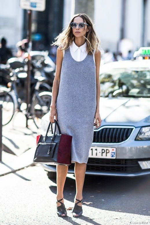 Le Fashion Blog Street Style Workwear Candela Novembre Layers Sleeveless Grey Dress Over A White Button Down Shirt Tote Bag Black Strappy Heels Via A Love Is Blind