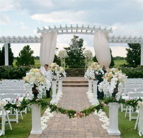 Simply stunning wedding ceremony floral by Atmospheres at