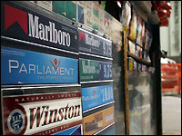 Cigarette ads are featured on a newspaper stand in New York City.