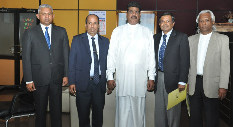 Fisheries and Aquatic Resources Development State Minister Dilip Wedaarachchi with CENORA executive members.