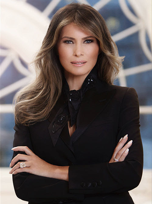 Melania Trump wore an elegant tailored suit with a matching scarf